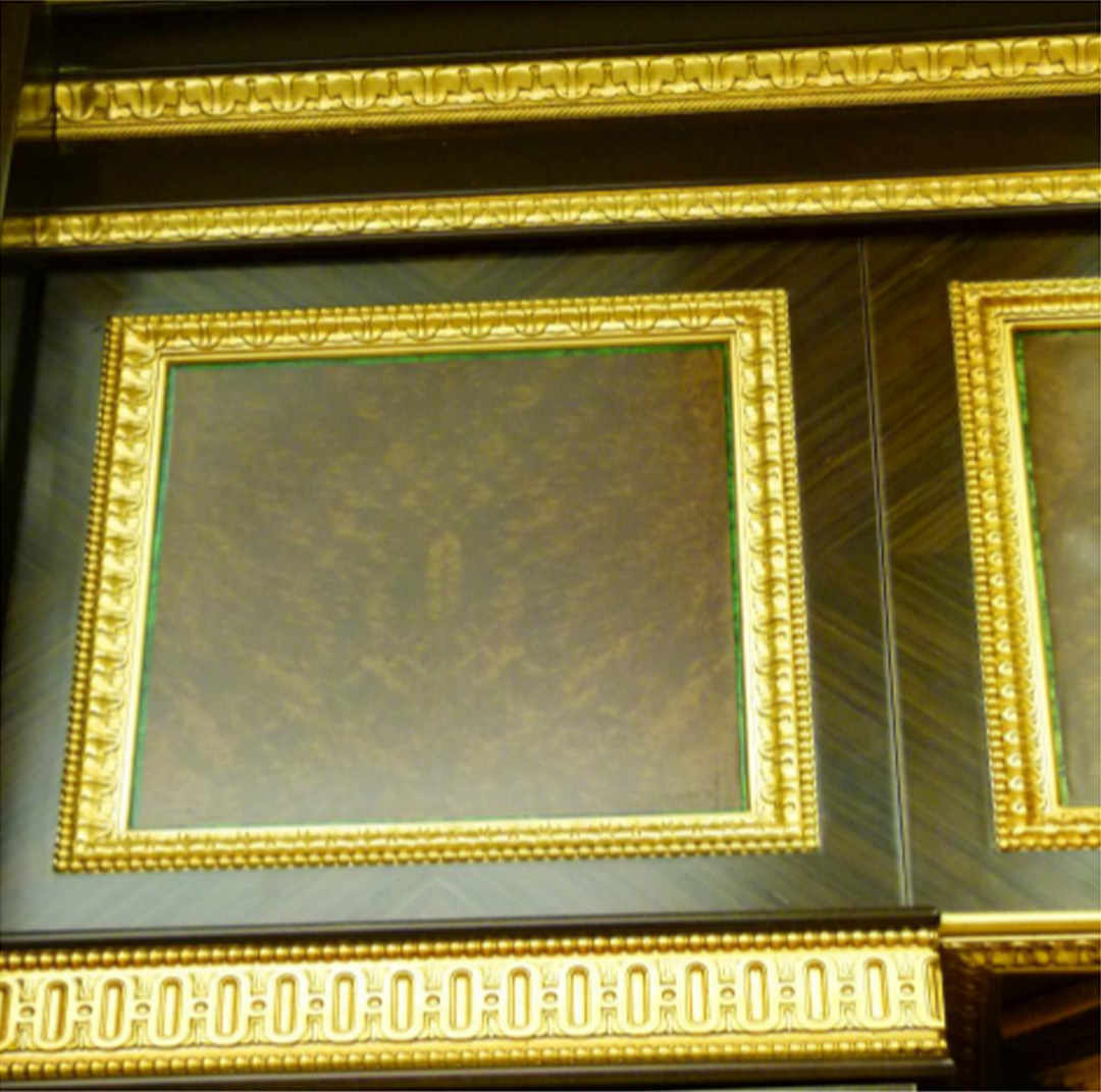 Wooden boiserie with gold painted carved mouldings
