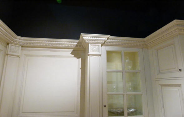 Carved wood moldings used as a frame for a wardrobe