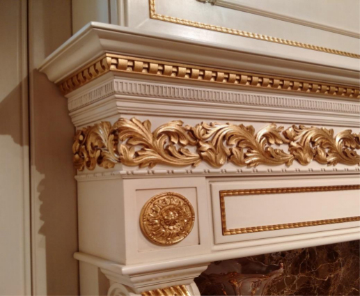 Fireplace mantel decorated with carved and painted wooden moldings